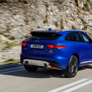 2017-Jaguar-F-Pace-First-Edition-rear-side-motion-view-and-mountain.jpg