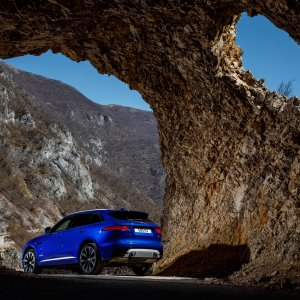 2017-Jaguar-F-Pace-First-Edition-rear-side-view-rocky-formation.jpg